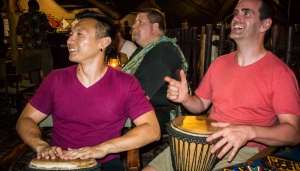 Learning how to drum on a djembe.